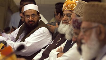 Hafiz Saeed (L), the head of Jamaat-ud-Dawa and founder of Lashkar-e-Taiba, attends a conference for ''safeguarding the honour of the Prophet Mohammad'', with other political and religious leaders in Islamabad September 26, 2012. REUTERS/Faisal Mahmood