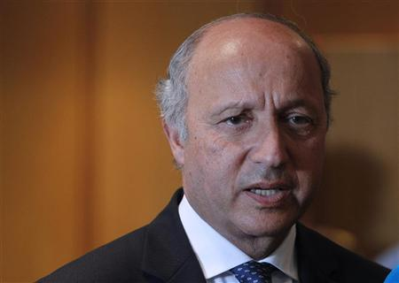 French Foreign Minister Laurent Fabius speaks with journalists upon his arrival at Beirut international airport August 16, 2012. REUTERS/Mohamed Azakir