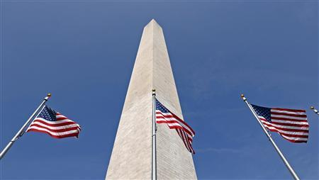 Flags fly beneath the Washington Monument in Washington September 26, 2012. The National Park Service has awarded a $9.6 million contract to Perini Management Services, Inc. of Framingham, Massachusetts to repair damage to the Washington Monument caused by a 5.8 magnitude earthquake that struck the Washington D.C. area in August of 2011. REUTERS/Kevin Lamarque