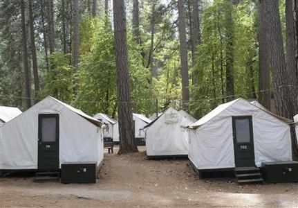A view of the locked tents in the Curry Village section of Yosemite National Park in California September 8, 2012. California researchers and public health officials have launched what they describe as a groundbreaking series of studies of a rare mouse-borne virus that has infected at least nine Yosemite National Park visitors, killing three of them, since June. All but one of the Yosemite visitors who contracted the disease over the summer are believed to have been exposed in Yosemite's Curry Village area while staying in double-walled tent cabins later found to have been infested by deer mice. Picture taken September 8. REUTERS/Gordon Bussard