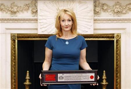 Author J.K Rowling poses for photos with her certificate after being presented with the Freedom of the City of London, at Mansion House, central London May 8, 2012. REUTERS/Andrew Winning