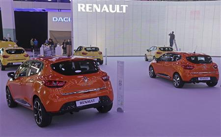 Cars are displayed at the Renault exhibition area on the eve of a media preview at the upcoming Paris Car Show September 26, 2012. REUTERS/Jacky Naegelen