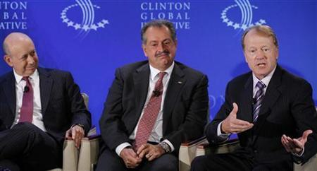 Lloyd Blankfein (L), Chairman and CEO of Goldman Sachs, Andrew Liveris (C), Chairman and CEO of the Dow Chemical Company, and John Chambers, Chairman and CEO of Cisco, participate in a group discussion on ''Business by Design: Business with Integrity'' during the second day of the Clinton Global Initiative 2012 (CGI) in New York on September 24, 2012. REUTERS/Lucas Jackson