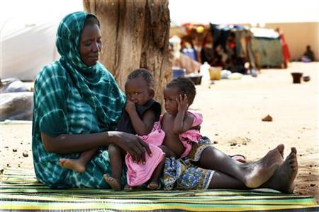 A Malian family displaced by war gather at a makeshift camp in Sevare, about 600 kms (400 miles) northeast of the capital Bamako, July 11, 2012. REUTERS/Emmanuel Braun