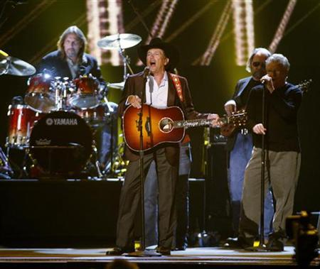 Singer George Strait performs ''Twang'' performs at the 43rd annual Country Music Association Awards in Nashville November 11, 2009. REUTERS/Tami Chappell/Files