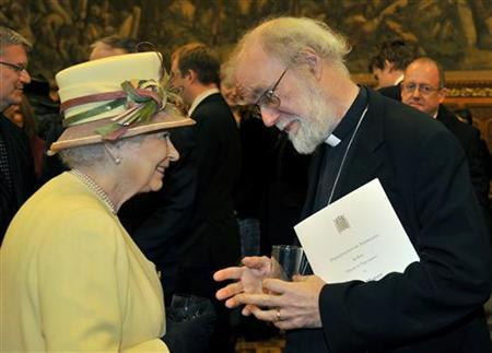 Britain's Queen Elizabeth speaks with Rowan Williams, The Archbishop of Canterbury during a reception at the Houses of Parliament in London March 20, 2012. REUTERS/Toby Melville