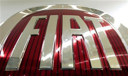 A logo of Fiat is seen at the Fiat plant in Pomigliano D'Arco, near Naples, in this December 14, 2011 file photo. REUTERS/Alessandro Bianchi
