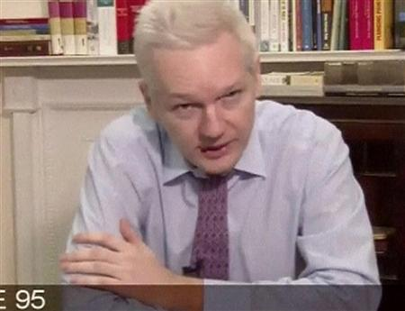 WikiLeaks' founder Julian Assange speaks during a teleconference from the Ecuadorian Embassy in London, in this still image taken from video broadcasted to the United Nations in New York, September 26, 2012. Assange, speaking via a choppy video feed from his virtual house arrest in London, lashed out at U.S. President Barack Obama on Wednesday for supporting freedom of speech in the Middle East while simultaneously ''persecuting'' his organization for leaking diplomatic cables. REUTERS/UNTV via Reuters TV