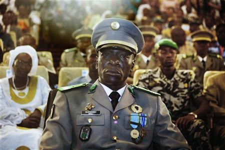 Coup leader Captain Amadou Sanogo attends a ceremony as former parliament speaker Dioncounda Traore (unseen) is sworn in as Mali's interim president in the captial Bamako, April 12, 2012. REUTERS/Malin Palm