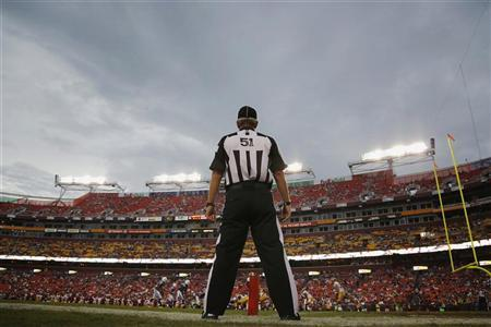 A referee takes his position on the sideline during an NFL preseason football game between the Indianapolis Colts and the Washington Redskins in Landover, Maryland, August 25, 2012. REUTERS/Jonathan Ernst