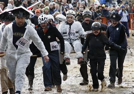 A team competes in the Coffin Races during Frozen Dead Guys Days in Nederland, Colorado in this March 8, 2008 file photo. TREUTERS/Rick Wilking/Files