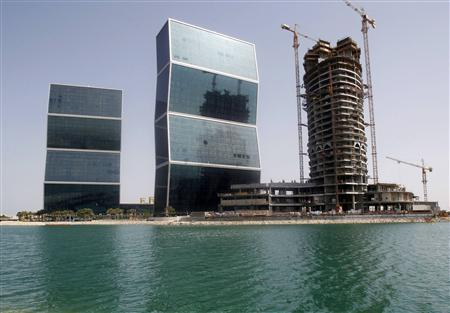 Construction cranes and bulldozers operate near Zig Zag Towers in Doha September 25, 2012. REUTERS/Mohammed Dabbous