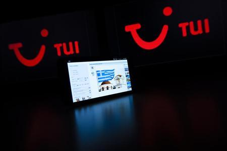 A booking page for holiday in Greece on a website of German tourism group TUI AG, owner of Europe's largest travel company TUI Travel, is pictured on a mobile phone in this illustration picture taken in Lavigny May 21, 2012. REUTERS/Valentin Flauraud