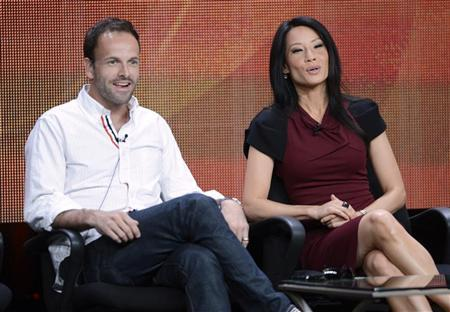 Cast members Jonny Lee Miller (L) and Lucy Liu participate in a panel for CBS series ''Elementary'' during the CBS sessions at the Television Critics Association summer press tour in Beverly Hills, California July 29, 2012. REUTERS/Phil McCarten