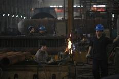 Employees work at a heavy equipment factory in Suzhou, Jiangsu province September 27, 2012. REUTER/Aly Song