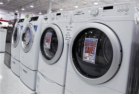 Washers and dryers are seen on display at a store in New York July 28, 2010. REUTERS/Shannon Stapleton