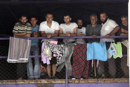 Syrian refugees are seen as U.N.-Arab League peace envoy for Syria Lakhdar Brahimi (not pictured) visits their camp in the Turkish border town of Altinozu in Hatay province September 18, 2012. REUTERS/Adem Altan/Pool