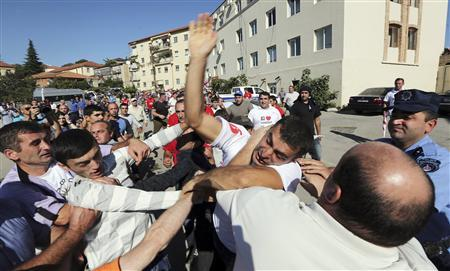 Supporters of the ruling National Movement Party scuffle with supporters of the opposition Georgian Dream coalition during an election rally in the town of Signagi, 115 km (71 miles) southeast of Tbilisi, September 26, 2012. REUTERS/Stringer