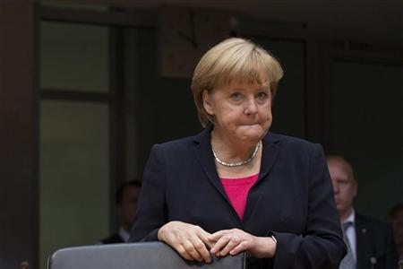 German Chancellor Angela Merkel takes her seat to answer to a parliamentary hearing about the Gorleben nuclear waste repository in Berlin, September 27, 2012. REUTERS/Thomas Peter