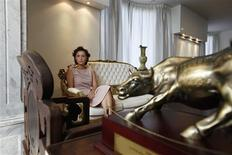 Gigi Chao, the daughter of Hong Kong property tycoon Cecil Chao Sze-tsung, poses at the conference room of her office in Hong Kong September 27, 2012. REUTERS/Bobby Yip