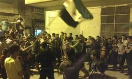 Demonstrators protest against Syria's President Bashar al-Assad in Erbeen near Damascus September 23, 2012. Picture taken September 23, 2012. REUTERS/Shaam News Network/Handout (SYRIA - Tags: POLITICS CIVIL UNREST CONFLICT) FOR EDITORIAL USE ONLY. NOT FOR SALE FOR MARKETING OR ADVERTISING CAMPAIGNS. THIS IMAGE HAS BEEN SUPPLIED BY A THIRD PARTY. IT IS DISTRIBUTED, EXACTLY AS RECEIVED BY REUTERS, AS A SERVICE TO CLIENTS
