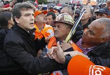 France's Minister for Industrial Recovery Arnaud Montebourg (L) talks to ArcelorMittal workers from Florange after a meeting with trade union representatives at the town hall in Florange, Eastern France, September 27, 2012. REUTERS/Vincent Kessler