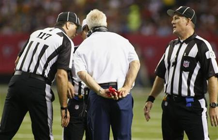 Denver Broncos head coach John Fox holds his challenge flag as he talks to referees during play against the Atlanta Falcons in the first half of their NFL football game in Atlanta, Georgia September 17, 2012. REUTERS/Tami Chappell