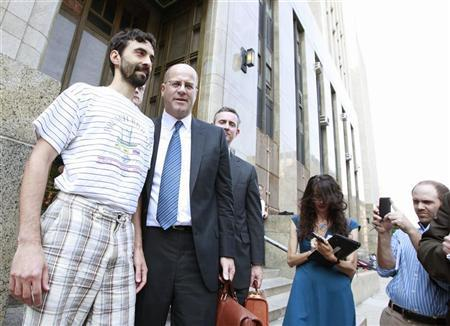 Former Goldman Sachs computer programmer Sergey Aleynikov (L) smiles as he exits Manhattan Criminal Court with his lawyer Kevin Marino (2nd L) in New York, August 9, 2012. REUTERS/Brendan McDermid