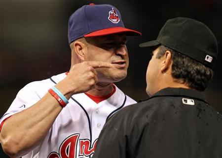 Cleveland Indians manager Manny Acta (L) argues with first base umpire Rob Drake in the eighth inning of their MLB American League baseball game against the Boston Red Sox in Cleveland, Ohio May 23, 2011. Acta was ejected from the game. REUTERS/Aaron Josefczyk