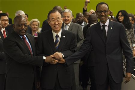 U.N. Secretary General Ban Ki-moon joins the hands of Rwandan President Paul Kagame (R) and Congolese President Joseph Kabila (L) at a meeting during the 67th United Nations General Assembly at the U.N. headquarters in New York September 27, 2012. REUTERS/Keith Bedford