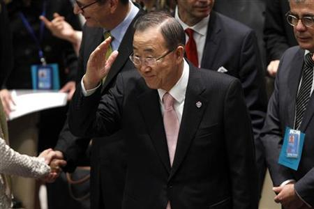 U.N. Secretary General Ban Ki-moon waves as delegates sit for a Security Council meeting to discuss Peace and Security in the Middle East during the 67th United Nations General Assembly at the U.N. Headquarters in New York, September 26, 2012. REUTERS/Keith Bedford