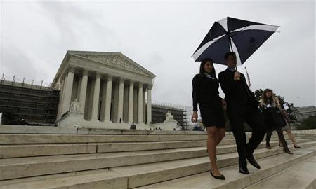 People depart the U.S. Supreme Court in Washington June 18, 2012. REUTERS/Kevin Lamarque