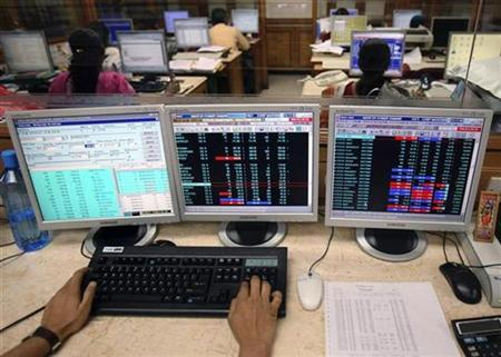 A stockbroker uses his terminal to trade at a brokerage firm in Mumbai September 30, 2008. REUTERS/Punit Paranjpe/Files