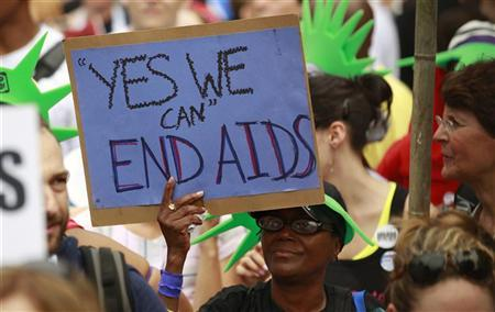AIDS activists take part in a rally across from the White House in Washington July 24, 2012. REUTERS/Kevin Lamarque