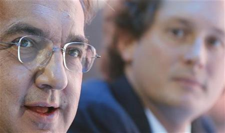 Fiat-Chrysler chief executive Sergio Marchionne (L) and Fiat Chairman John Elkann (R) attend the launching of the Fiat Panda Trekking model on media day at the Paris Mondial de l'Automobile September 27, 2012. REUTERS/Jacky Naegelen
