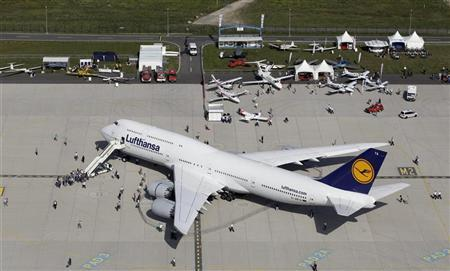 A Lufthansa Boeing 747-8 aircraft is on display during the opening day of ILA Berlin Air Show in Selchow near Schoenefeld south of Berlin, September 11, 2012. REUTERS/Tobias Schwarz