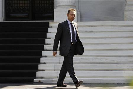 Greek Finance Minister Yannis Stournaras leaves after a meeting with Prime Minister Antonis Samaras at the Prime Minister's office in Athens September 20, 2012. REUTERS/John Kolesidis