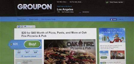An online coupon sent via email from Groupon is pictured on a laptop screen in Los Angeles in this November 29, 2010 file photograph. Groupon Inc, the world's largest online daily deals provider, is reshuffling senior management roles in an attempt to fix its struggling European business -- a shake-up that will also include the departure of Veit Dengler, chief of international business. To match Exclusive GROUPON-MANAGEMENT/ REUTERS/Fred Prouser/Files