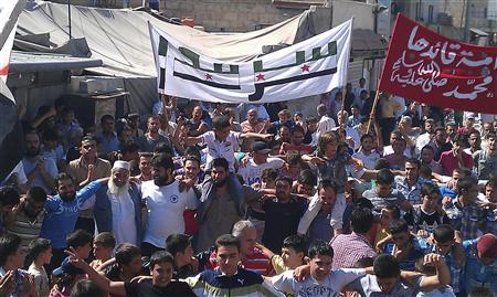 Members of the Free Syrian Army and residents protest against Syria's President Bashar al-Assad after Friday prayers in Sermada, near Idlib September 28, 2012. REUTERS/Shaam News Network/Handout