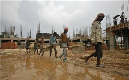 Labourers work at the construction site of a stadium on the outskirts of Agartala September 28, 2012. REUTERS/Jayanta Dey