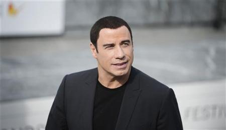 U.S. actor John Travolta poses during a photocall to promote the film Savages on the third day of the San Sebastian Film Festival September 23, 2012.. REUTERS/Vincent West