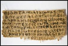 An ancient papyrus written in ancient Egyptian Coptic is pictured in this undated handout image. The fragment which a Harvard scholar says contains the first recorded mention that Jesus may have had a wife is a fake, the Vatican said on Friday. REUTERS/Karen L. King/Harvard University/Handout