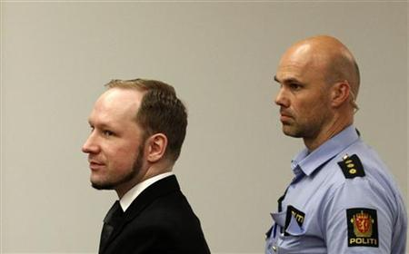 Norwegian mass killer Anders Behring Breivik (L) reacts as he returns after a break to the court room, in Oslo Courthouse August 24, 2012. REUTERS/Stoyan Nenov/Files