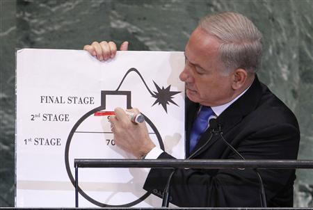Israeli Prime Minister Benjamin Netanyahu draws a red line on a graphic of a bomb as he addresses the 67th United Nations General Assembly at the U.N. headquarters in New York September 27, 2012. REUTERS/Lucas Jackson