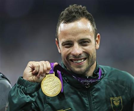 South Africa's Oscar Pistorius celebrates with his gold medal after winning the men's 400m T44 classification at the Olympic Stadium during the London 2012 Paralympic Games September 8, 2012. REUTERS/Eddie Keogh