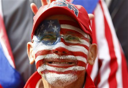 A U.S golf fan watches play on the 18th green during the morning foursomes round at the 39th Ryder Cup golf matches at the Medinah Country Club in Medinah, Illinois, September 28, 2012. REUTERS/Jim Young