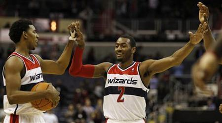 Washington Wizards' John Wall (R) celebrates with teammate Nick Young (L) during overtime of their NBA basketball game against the Toronto Raptors in Washington February 6, 2012. REUTERS/Larry Downing