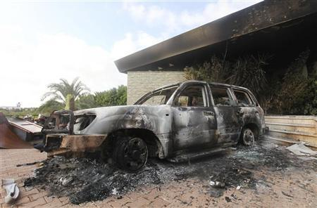 A burnt car is parked at the U.S. consulate, which was attacked and set on fire by gunmen, in Benghazi September 12, 2012. REUTERS/Esam Al-Fetori