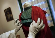 "A restoration expert arranges the ruffles on a blouse that belonged to iconic Mexican painter Frida Kahlo at the ""Blue House"" in the neighborhood of Coyoacan in Mexico City September 27, 2012. REUTERS/Claudia Daut"