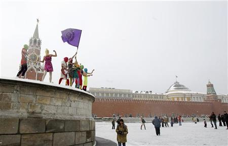 Members of the Russian radical feminist group 'Pussy Riot' sing a song at the so-called Lobnoye Mesto (Forehead Place), long before used for announcing Russian tsars' decrees and occasionally for carrying out public executions, in Red Square in Moscow January 20, 2012. REUTERS/Denis Sinyakov